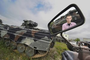 The company's CEO in the midst of the tanks still to be scrapped.