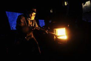 Stoker Martin Schmidt feeds the enginee with coal.