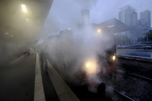 With a lot of steam and smoke, the train stops at various stations along the journey.