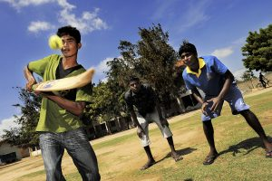 After school some boys from the former LTTE / Tamil Tigers rebel army play cricket in the Don Bosco facility in Mannar.