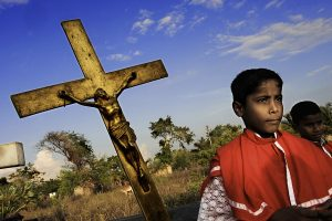 Former child soldiers voluntarily take part in church services and processions.