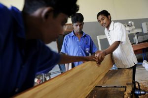 The Salesian workshops are well stocked. Here, former fighters learn the carpentry trade.