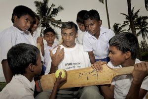 Father Sunil Perera discusses the strategy for the next game of cricket with the boys.