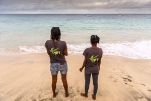 Two volunteers look after some just hatched turtles that have been released and hope for their survival.